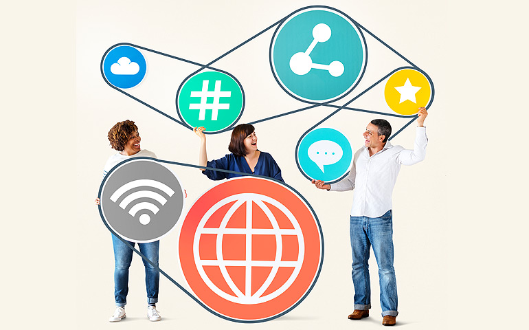 People holding internet icon symbols