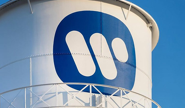 Warner Music logo on a water tower